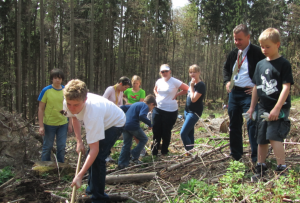 FIS students plant new trees in a storm-damaged section of the Taunus Mountains, which surround the school surrounding